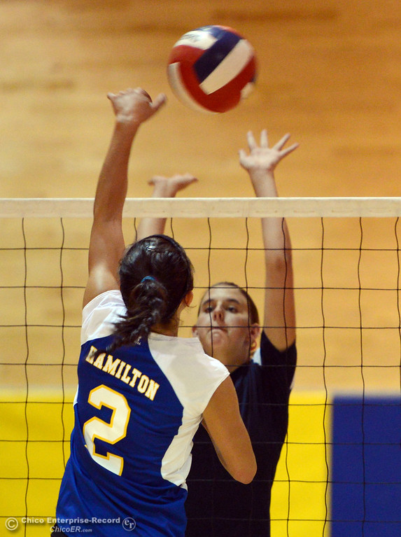 Description of . Hamilton High's #2 Raegan Avrit (left) spikes against Gridley High's #15 Kaelin Rice (right) in their second game of their volleyball match Thursday, August 29, 2013 in Chico, Calif.  (Jason Halley/Chico Enterprise-Record)