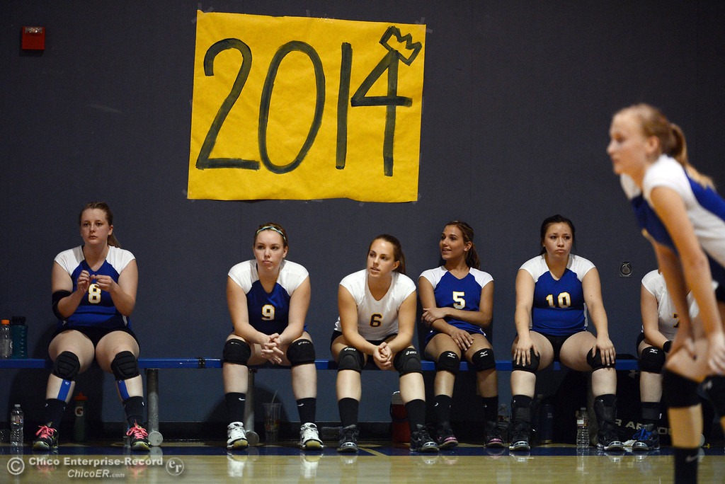Description of . Hamilton High team watches from the bench against Gridley High in their second game of their volleyball match Thursday, August 29, 2013 in Chico, Calif.  (Jason Halley/Chico Enterprise-Record)