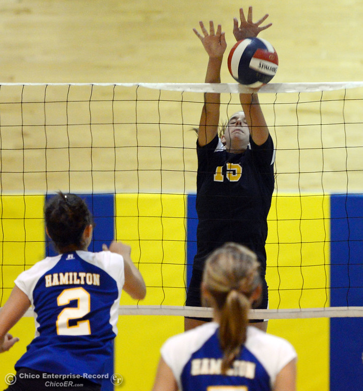 Description of . Gridley High's #15 Kaelin Rice (center) blocks against Hamilton High's #2 Raegan Avrit (left) in their second game of their volleyball match Thursday, August 29, 2013 in Chico, Calif.  (Jason Halley/Chico Enterprise-Record)
