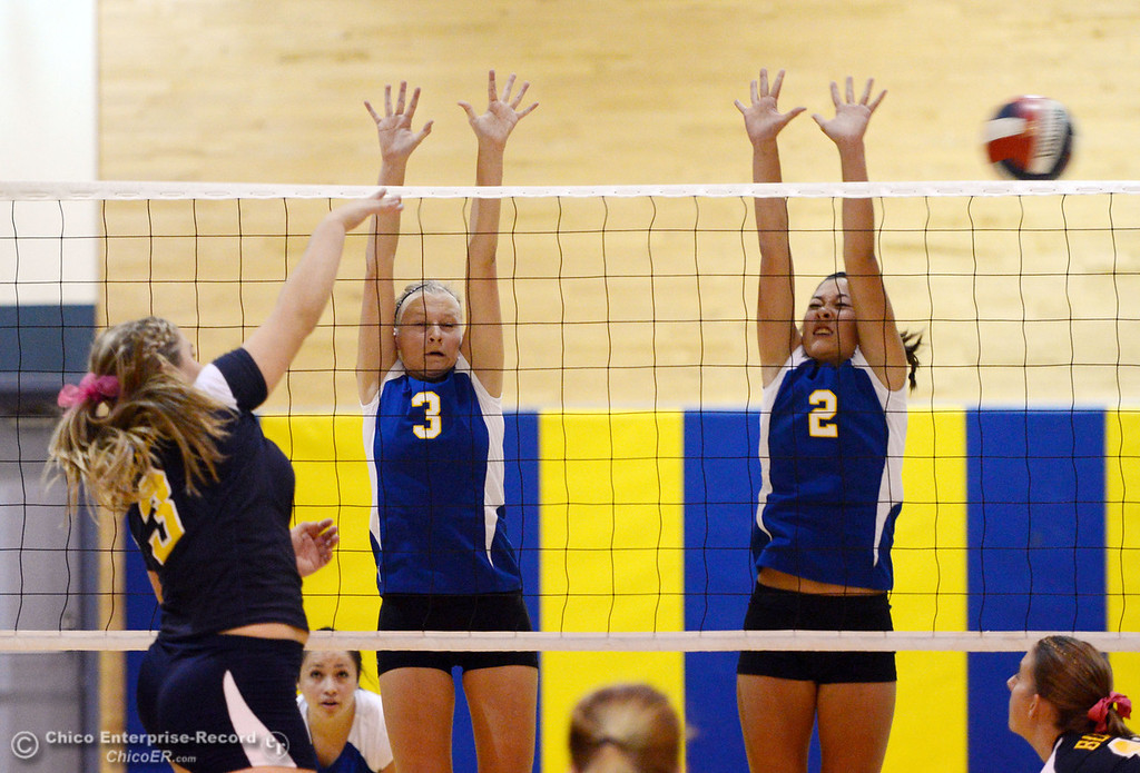 Description of . Gridley High's #3 Megan Anthony (left) spikes the ball against Hamilton High's #3 Kendra Gordon (center) and #2 Raegan Avrit (right) in their first game of their volleyball match Thursday, August 29, 2013 in Chico, Calif.  (Jason Halley/Chico Enterprise-Record)