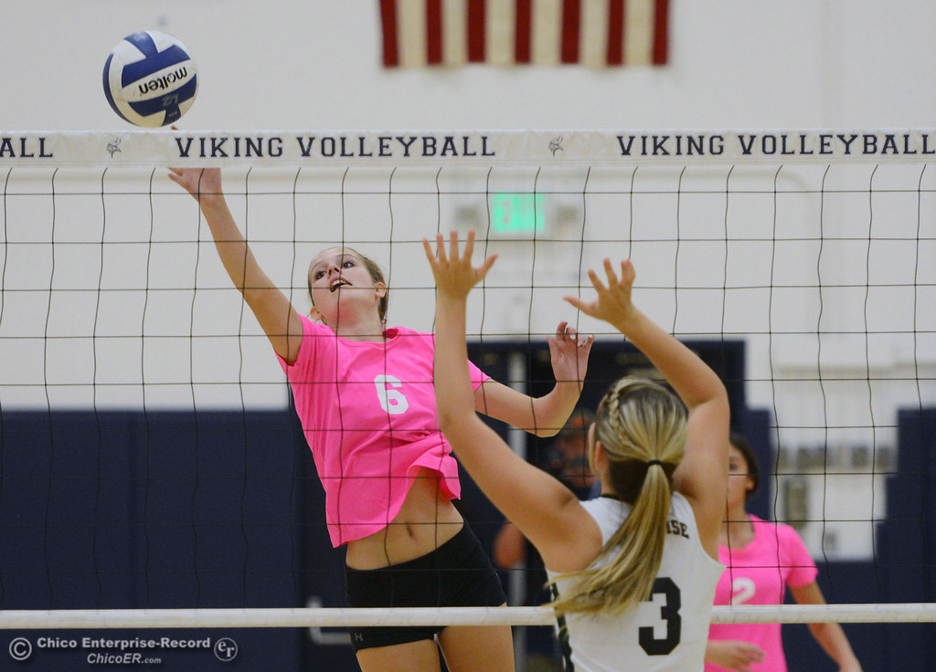 "Description of . Pleasant Valley High\'s #6 Hanne Henriksen (left) reaches out to hit the ball against Paradise High\'s #3 Kelsi  Earhart (right) in the second game of their volleyball match at PVHS Varley Gym Thursday, October 17, 2013 in Chico, Calif. PV volleyball wore pink instead of blue vs Paradise at ""Fight Like a Viking Night,\"" to raise money for cancer research. (Jason Halley/Chico Enterprise-Record)"