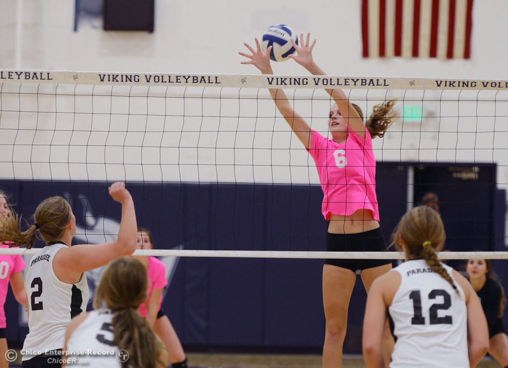 "Description of . Pleasant Valley High\'s #6 Hanne Henriksen misses a block against Paradise High in the second game of their volleyball match at PVHS Varley Gym Thursday, October 17, 2013 in Chico, Calif. PV volleyball wore pink instead of blue vs Paradise at ""Fight Like a Viking Night,\"" to raise money for cancer research. (Jason Halley/Chico Enterprise-Record)"