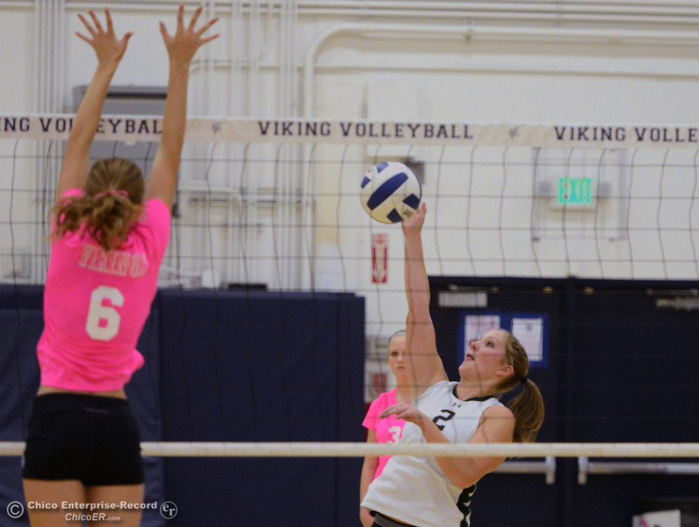 "Description of . Pleasant Valley High\'s #6 Hanne Henriksen (left) attempts to block against Paradise High\'s #2 Bailey Bengson (right) in the first game of their volleyball match at PVHS Varley Gym Thursday, October 17, 2013 in Chico, Calif. PV volleyball wore pink instead of blue vs Paradise at ""Fight Like a Viking Night,\"" to raise money for cancer research. (Jason Halley/Chico Enterprise-Record)"