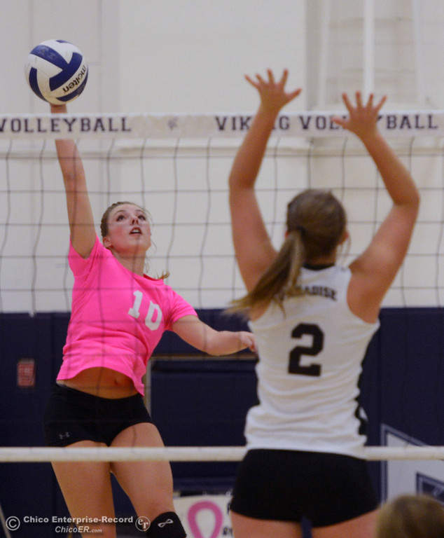 "Description of . Pleasant Valley High\'s #10 Ashley Geiger (left) spikes against Paradise High\'s #2 Bailey Bengson (right) in the second game of their volleyball match at PVHS Varley Gym Thursday, October 17, 2013 in Chico, Calif. PV volleyball wore pink instead of blue vs Paradise at ""Fight Like a Viking Night,\"" to raise money for cancer research. (Jason Halley/Chico Enterprise-Record)"