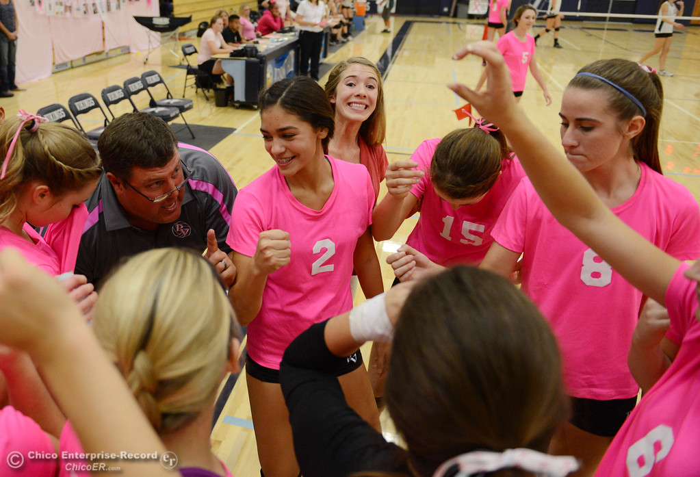 "Description of . Pleasant Valley High against Paradise High in the second game of their volleyball match at PVHS Varley Gym Thursday, October 17, 2013 in Chico, Calif. PV volleyball wore pink instead of blue vs Paradise at ""Fight Like a Viking Night,\"" to raise money for cancer research. (Jason Halley/Chico Enterprise-Record)"