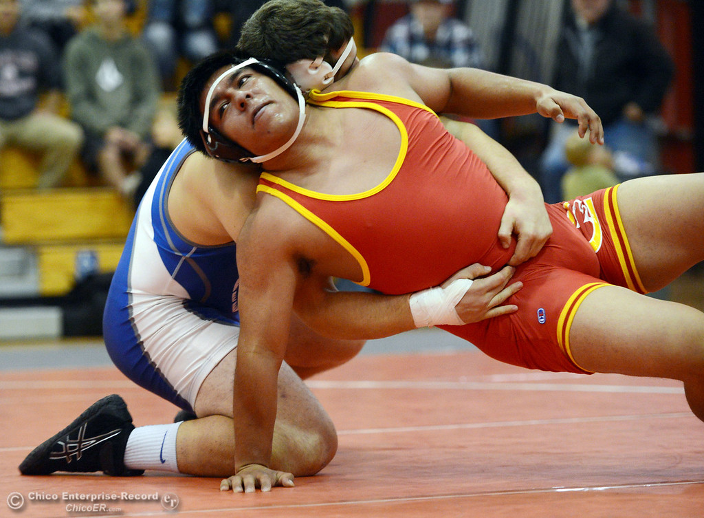 Description of . Chico High's Alex Coria (right) wrestles against Orland High's Vic Rayhoza (left) in the 220 lbs wrestling match at CHS Wednesday, December 18, 2013 in Chico, Calif. (Jason Halley/Chico Enterprise-Record)