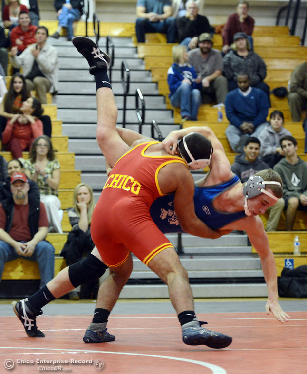 Description of . Chico High\'s John Leal (left) wrestles against Orland High\'s Lane Williams (right) in the 170 lbs wrestling match at CHS Wednesday, December 18, 2013 in Chico, Calif. (Jason Halley/Chico Enterprise-Record)
