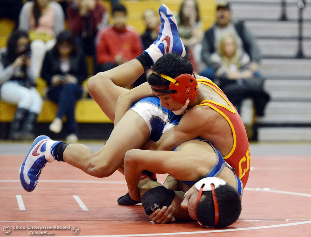 Description of . Chico High's Morgan Sauseda (right) wrestles against Orland High's Hugo Punzo (left) in the 113 lbs wrestling match at CHS Wednesday, December 18, 2013 in Chico, Calif. (Jason Halley/Chico Enterprise-Record)