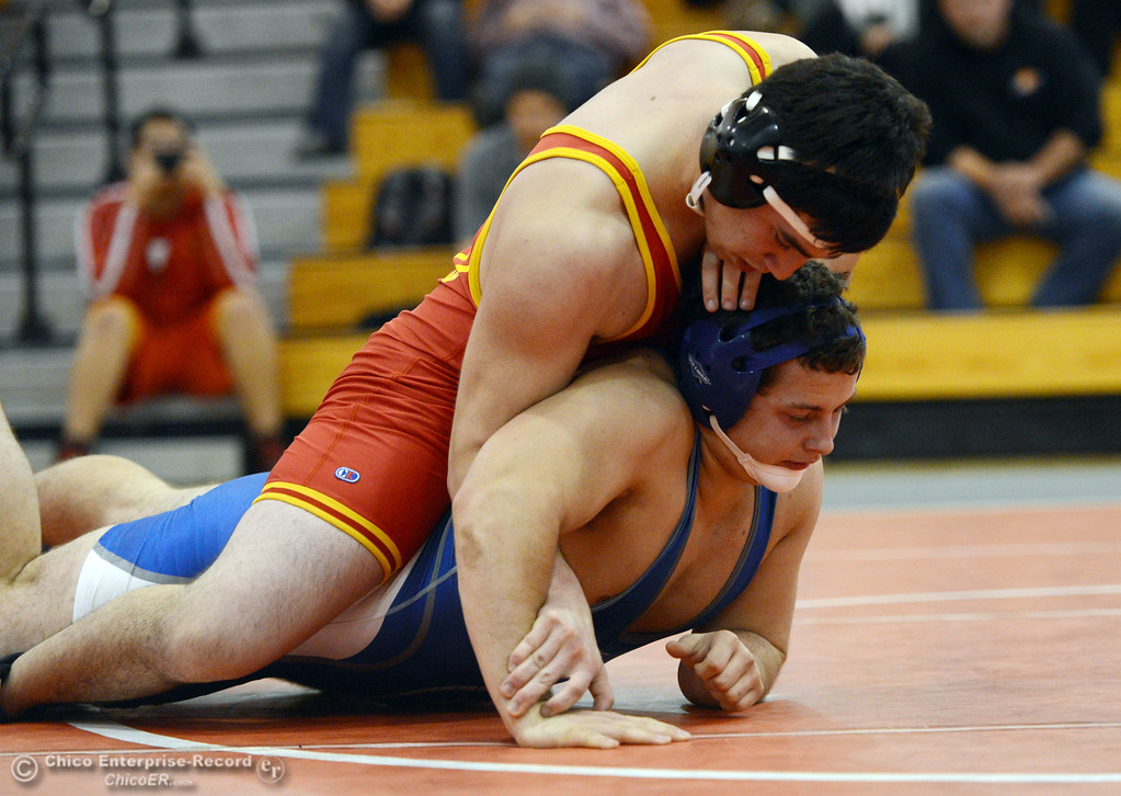 Description of . Chico High's Santino Giambalvo (left) wrestles against Orland High's Domenic Alves (right) in the 195 lbs wrestling match at CHS Wednesday, December 18, 2013 in Chico, Calif. (Jason Halley/Chico Enterprise-Record)