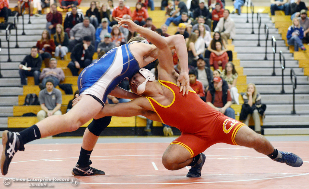 Description of . Chico High's John Leal (right) wrestles against Orland High's Lane Williams (left) in the 170 lbs wrestling match at CHS Wednesday, December 18, 2013 in Chico, Calif. (Jason Halley/Chico Enterprise-Record)
