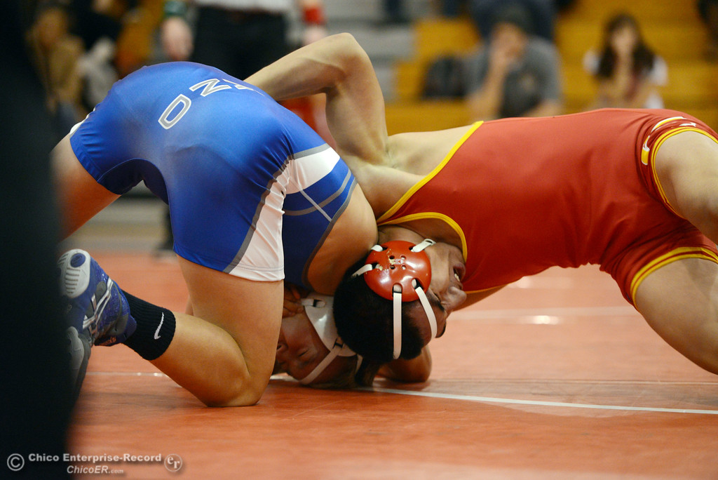 Description of . Chico High's David Leyva (right) wrestles against Orland High's Quinton Hill (left) in the 145 lbs wrestling match at CHS Wednesday, December 18, 2013 in Chico, Calif. (Jason Halley/Chico Enterprise-Record)