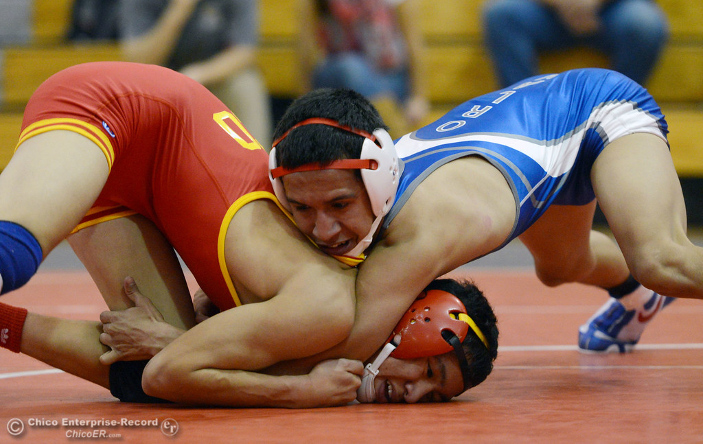 Description of . Chico High's Morgan Sauseda (left) wrestles against Orland High's Hugo Punzo (right) in the 113 lbs wrestling match at CHS Wednesday, December 18, 2013 in Chico, Calif. (Jason Halley/Chico Enterprise-Record)