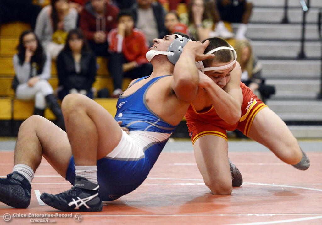 Description of . Chico High\'s Nicholas Maximov (right) wrestles against Orland High\'s Omar Ortega (left) in the 182 lbs wrestling match at CHS Wednesday, December 18, 2013 in Chico, Calif. (Jason Halley/Chico Enterprise-Record)