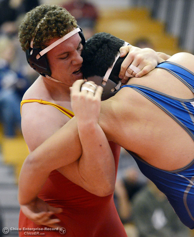 Description of . Chico High\'s Malik Hopkins (left) wrestles against Orland High\'s Carlos Gomez (right) in the 285 lbs wrestling match at CHS Wednesday, December 18, 2013 in Chico, Calif. (Jason Halley/Chico Enterprise-Record)