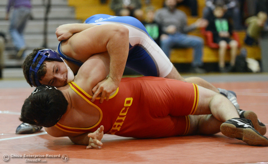 Description of . Chico High's Santino Giambalvo (bottom) wrestles against Orland High's Domenic Alves (top) in the 195 lbs wrestling match at CHS Wednesday, December 18, 2013 in Chico, Calif. (Jason Halley/Chico Enterprise-Record)