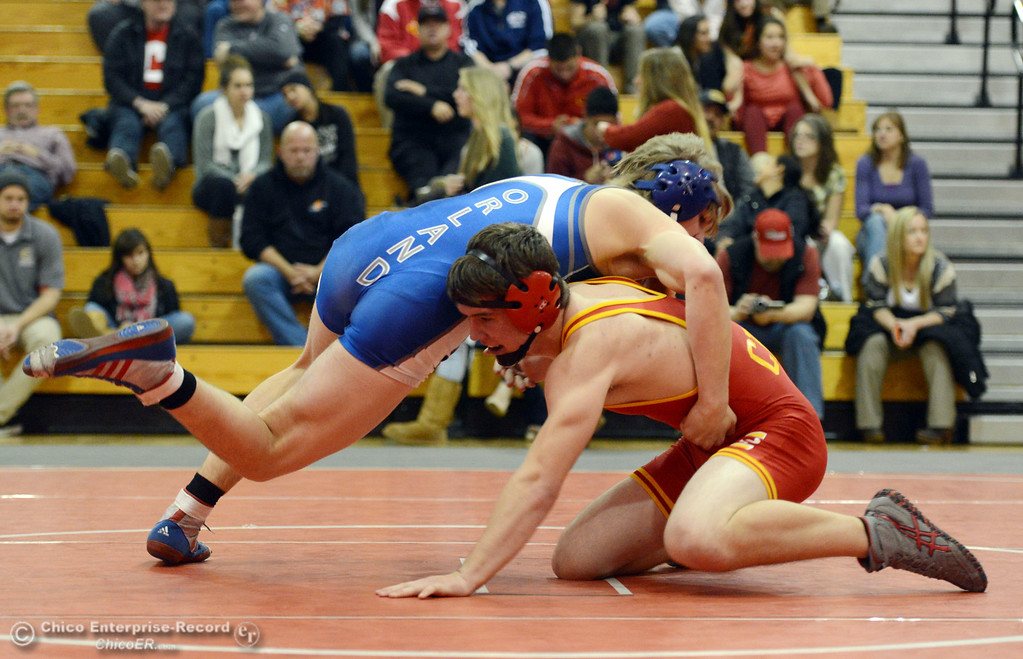 Description of . Chico High's Graham Kearns (right) wrestles against Orland High's Dallas Deatherage (left) in the 160 lbs wrestling match at CHS Wednesday, December 18, 2013 in Chico, Calif. (Jason Halley/Chico Enterprise-Record)