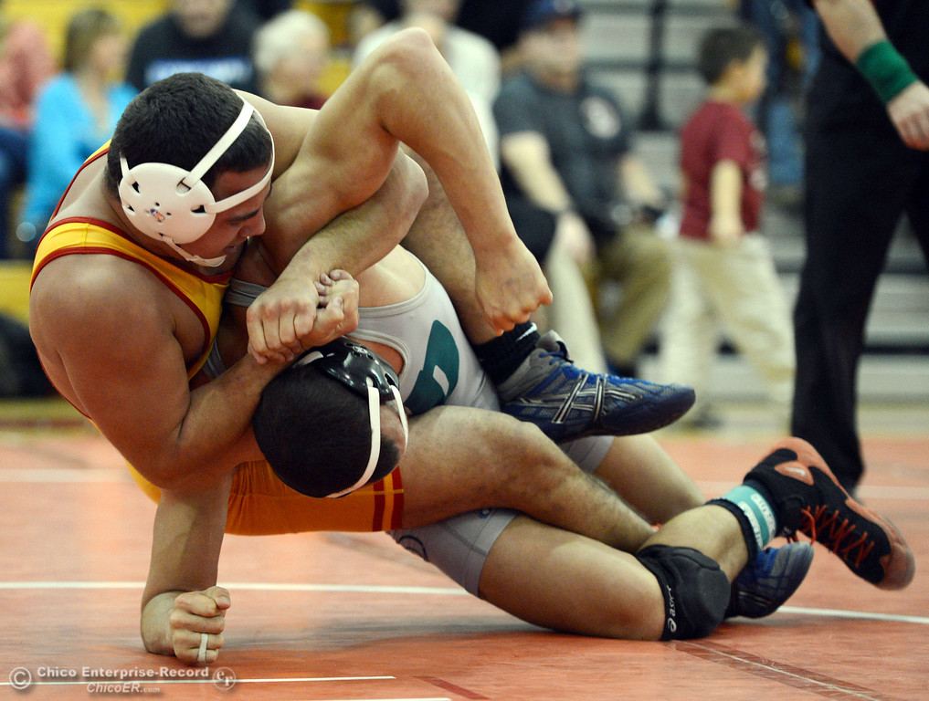 Description of . Chico High's John Leal (left) wrestles against Ponderosa High's Trea Providence (right) in their 170 lbs match at the Joe Rios Memorial Wrestling Tournament at CHS Saturday, January 4, 2014 in Chico, Calif.  (Jason Halley/Chico Enterprise-Record)