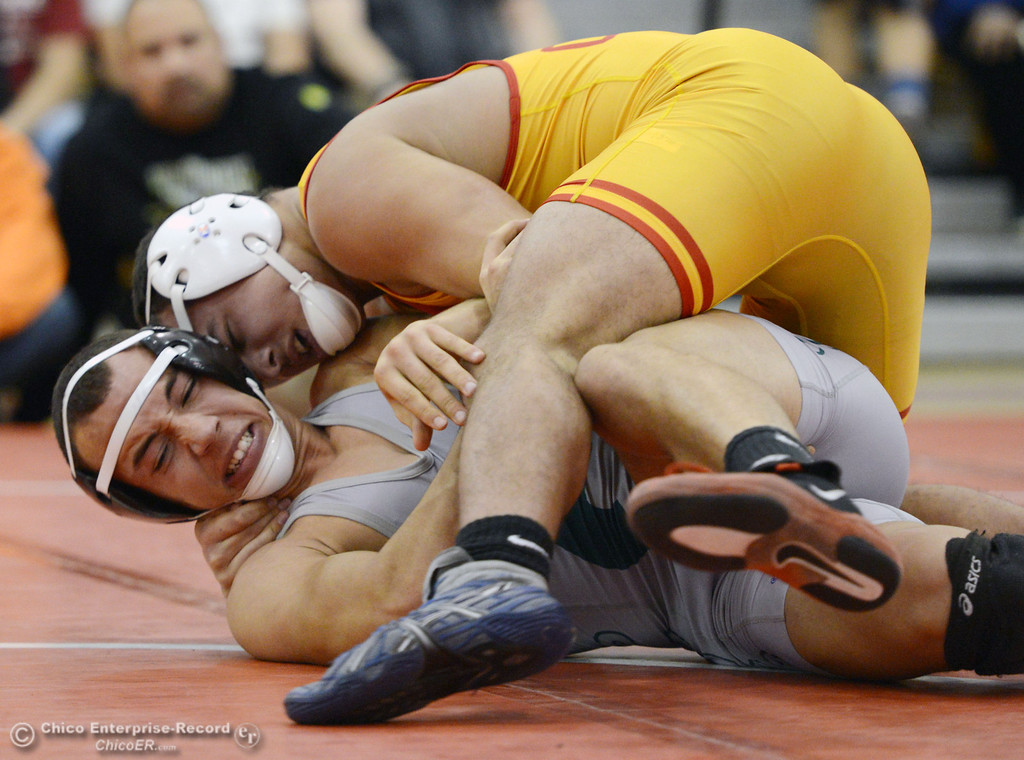 Description of . Chico High's John Leal (top) wrestles against Ponderosa High's Trea Providence (bottom) in their 170 lbs match at the Joe Rios Memorial Wrestling Tournament at CHS Saturday, January 4, 2014 in Chico, Calif.  (Jason Halley/Chico Enterprise-Record)