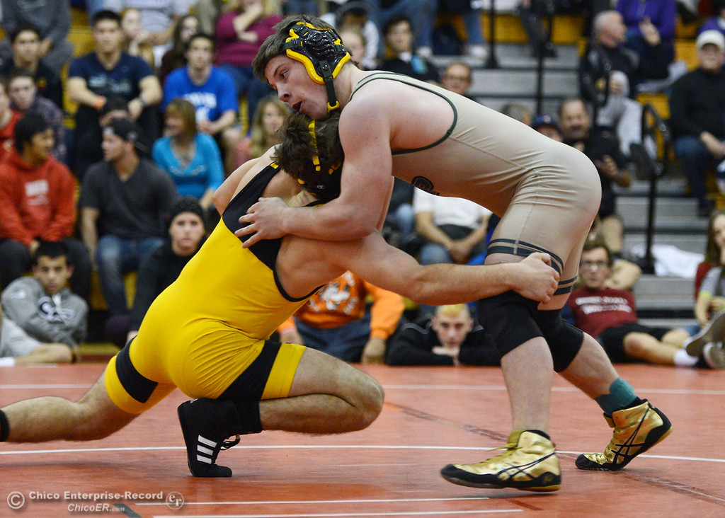 Description of . Paradise High\'s Wyatt Wyckoff (right) wrestles against Del Oro High\'s Dustin Edwards (left) in their 145 lbs match at the Joe Rios Memorial Wrestling Tournament at CHS Saturday, January 4, 2014 in Chico, Calif.  (Jason Halley/Chico Enterprise-Record)
