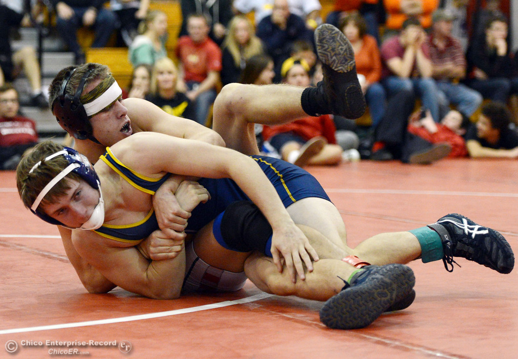 Description of . Las Plumas High\'s Lake Gee (back) wrestles against Henley High\'s Cooper Noonan (front) in their 138 lbs match at the Joe Rios Memorial Wrestling Tournament at CHS Saturday, January 4, 2014 in Chico, Calif.  (Jason Halley/Chico Enterprise-Record)