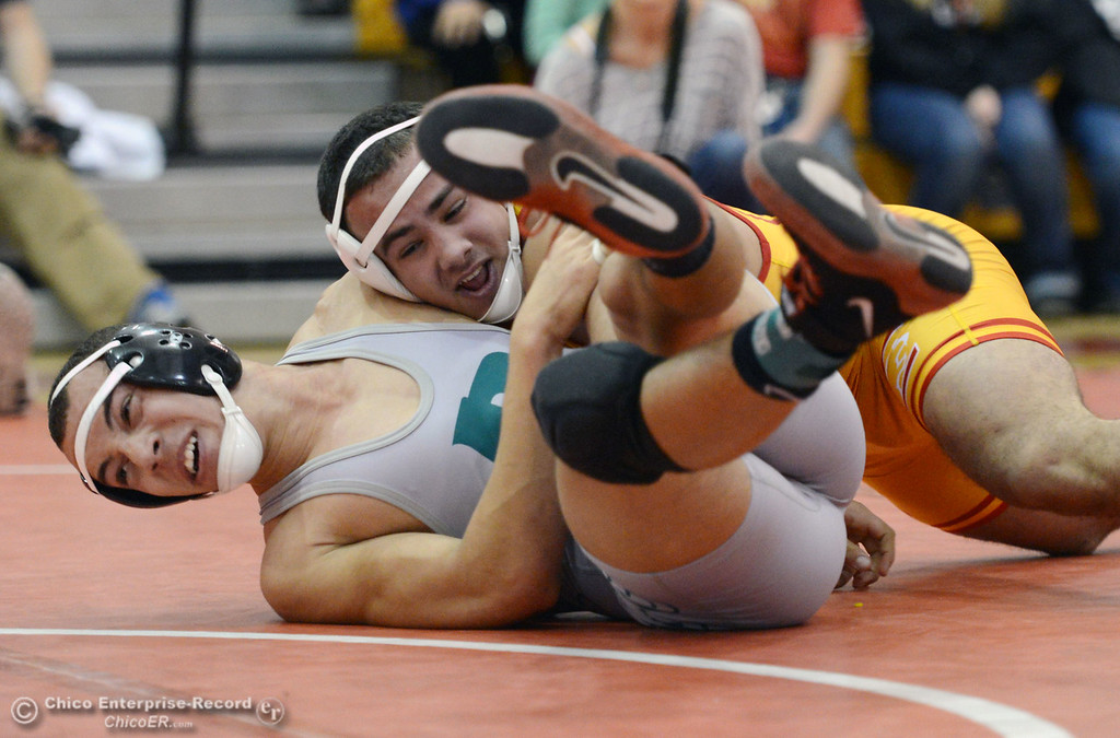 Description of . Chico High\'s John Leal (back) wrestles against Ponderosa High\'s Trea Providence (front) in their 170 lbs match at the Joe Rios Memorial Wrestling Tournament at CHS Saturday, January 4, 2014 in Chico, Calif.  (Jason Halley/Chico Enterprise-Record)