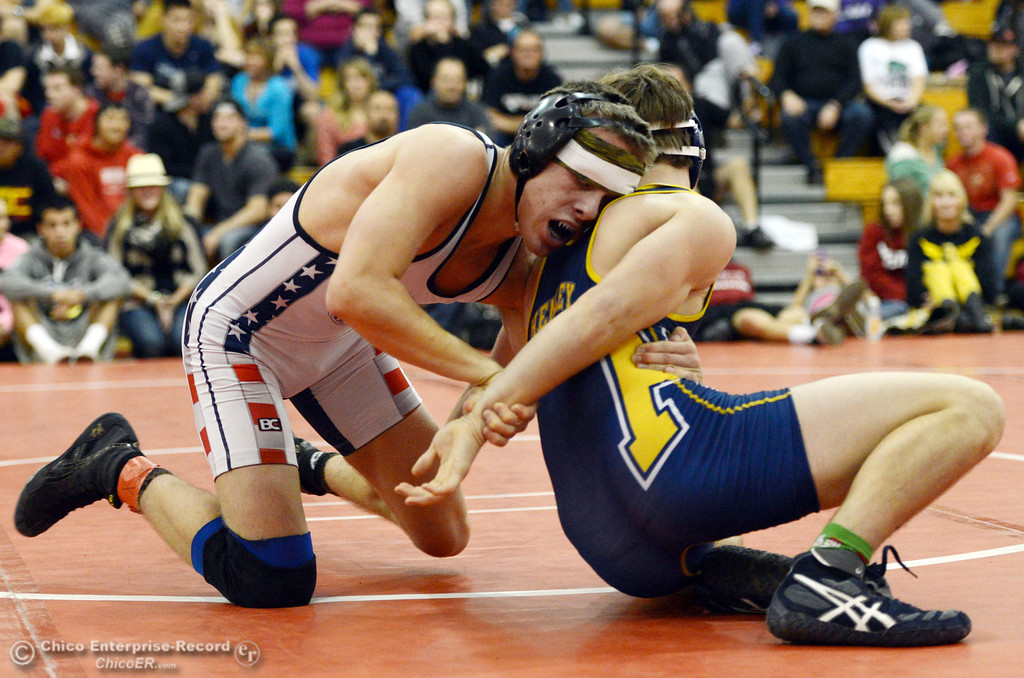 Description of . Las Plumas High\'s Lake Gee (left) wrestles against Henley High\'s Cooper Noonan (right) in their 138lbs match at the Joe Rios Memorial Wrestling Tournament at CHS Saturday, January 4, 2014 in Chico, Calif.  (Jason Halley/Chico Enterprise-Record)