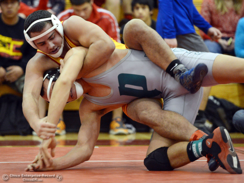 Description of . Chico High's John Leal (back) wrestles against Ponderosa High's Trea Providence (front) in their 170 lbs match at the Joe Rios Memorial Wrestling Tournament at CHS Saturday, January 4, 2014 in Chico, Calif.  (Jason Halley/Chico Enterprise-Record)