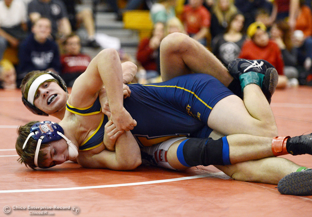 Description of . Las Plumas High\'s Lake Gee (back) wrestles against Henley High\'s Cooper Noonan (front) in their 138lbs match at the Joe Rios Memorial Wrestling Tournament at CHS Saturday, January 4, 2014 in Chico, Calif.  (Jason Halley/Chico Enterprise-Record)