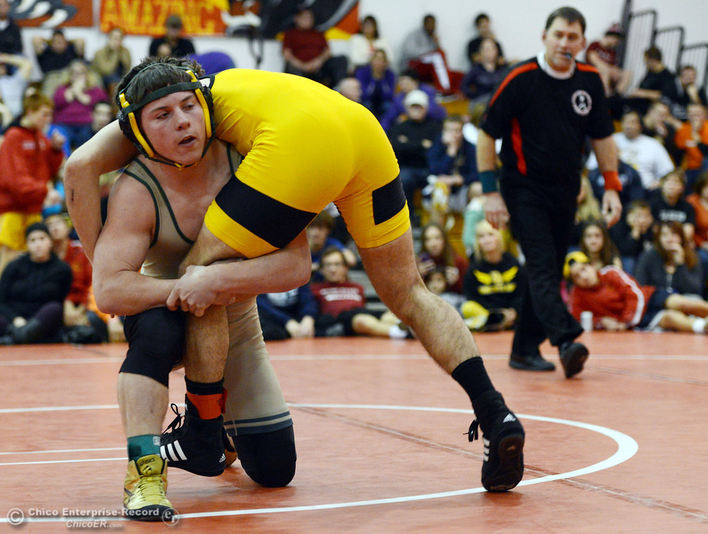 Description of . Paradise High\'s Wyatt Wyckoff (left) wrestles against Del Oro High\'s Dustin Edwards (right) in their 145 lbs match at the Joe Rios Memorial Wrestling Tournament at CHS Saturday, January 4, 2014 in Chico, Calif.  (Jason Halley/Chico Enterprise-Record)