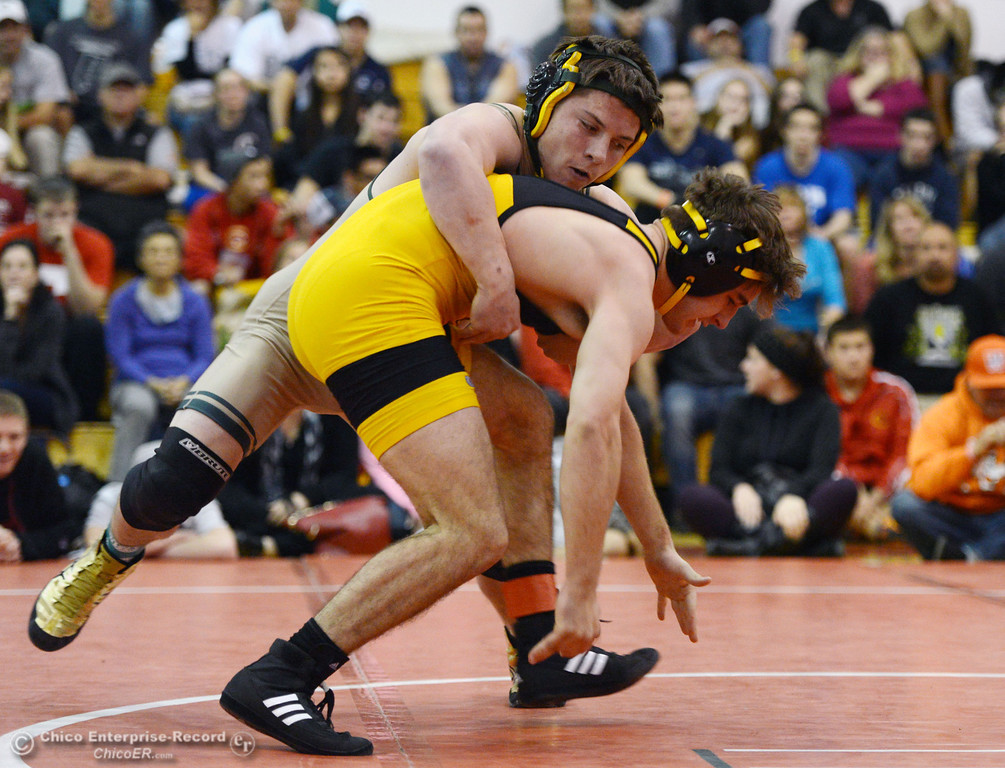 Description of . Paradise High's Wyatt Wyckoff (left) wrestles against Del Oro High's Dustin Edwards (right) in their 145 lbs match at the Joe Rios Memorial Wrestling Tournament at CHS Saturday, January 4, 2014 in Chico, Calif.  (Jason Halley/Chico Enterprise-Record)