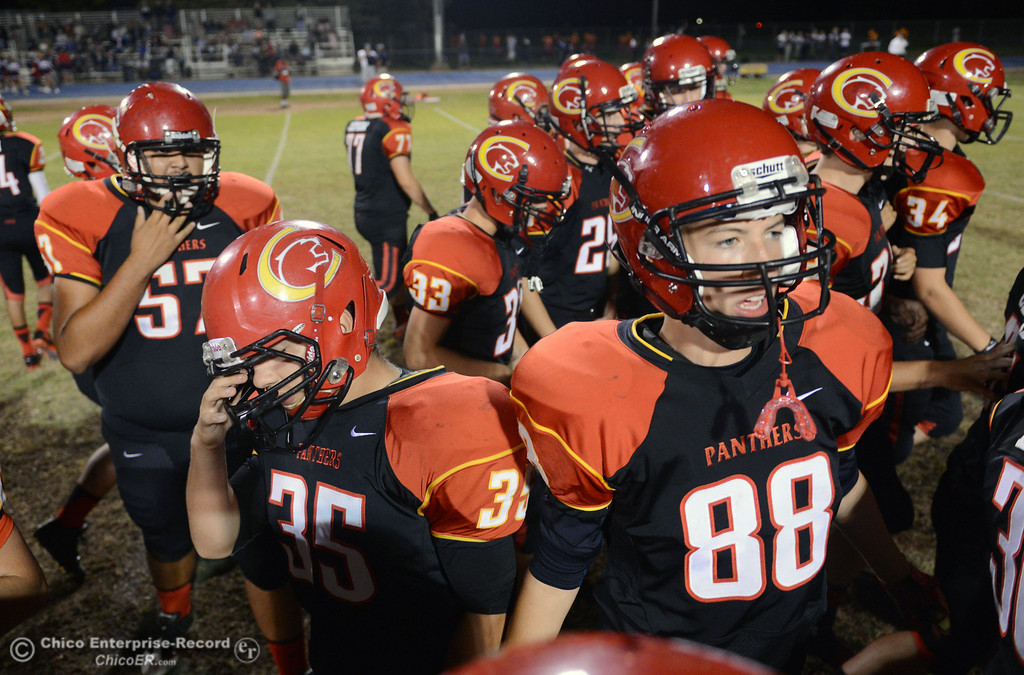 . Chico High\'s #57 Santiago Soto , #35 Emiliano Chavez, and #88 Ryan Larrabee (left to right) take the field against Central Valley High before the first quarter of their football game at Asgard Yard Friday, September 27, 2013, in Chico, Calif.  (Jason Halley/Chico Enterprise-Record)