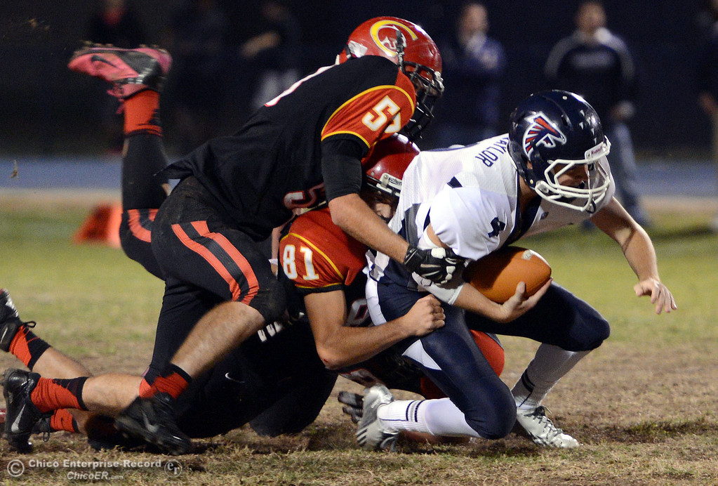 . Chico High\'s #81 Nathan Heyl (bottom) and #53 Cameron Power (left) tackle against Central Valley High\'s #4 Timmy Naylor (right) in the first quarter of their football game at Asgard Yard Friday, September 27, 2013, in Chico, Calif.  (Jason Halley/Chico Enterprise-Record)
