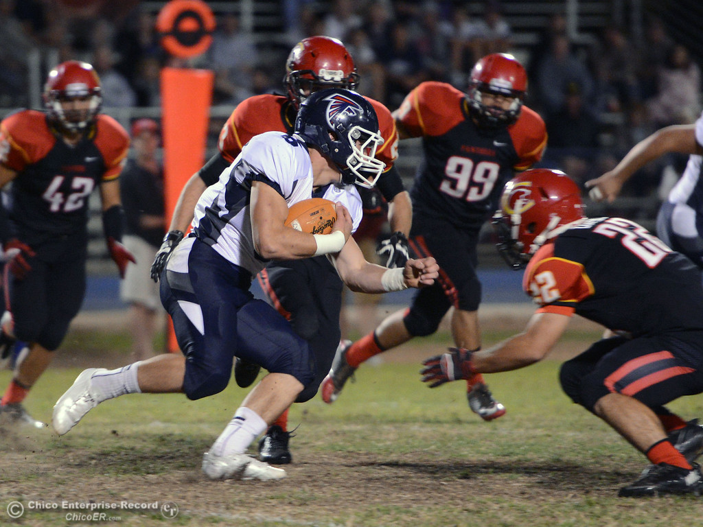 . Chico High\'s #22 Paolo DiSano (right) tackles against Central Valley High\'s #6 Connor Silveria (left) in the first quarter of their football game at Asgard Yard Friday, September 27, 2013, in Chico, Calif.  (Jason Halley/Chico Enterprise-Record)