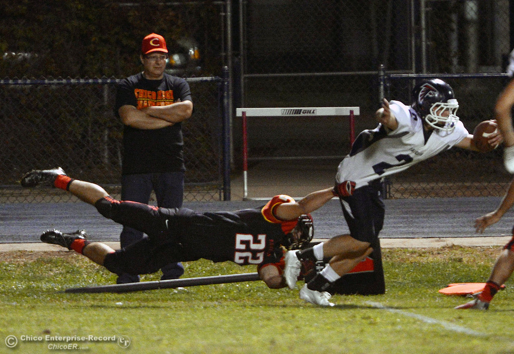 . Chico High\'s #22 Paolo DiSano (left) tackles against Central Valley High\'s #2 Sawyer McDonald (right) in the first quarter of their football game at Asgard Yard Friday, September 27, 2013, in Chico, Calif.  (Jason Halley/Chico Enterprise-Record)