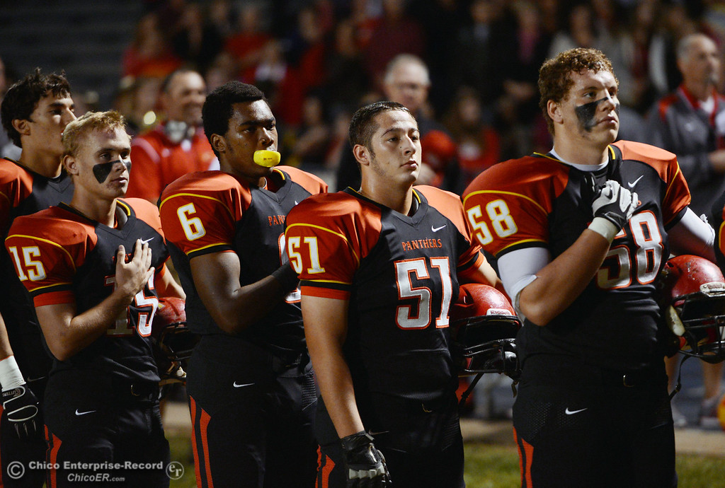 . Chico High\'s #15 Miles Fishback, #6 Darius Broadway, #51 Kody Sonday and #58 Malik Hopkins (left to right) stand for the National Anthem against Central Valley High in the first quarter of their football game at Asgard Yard Friday, September 27, 2013, in Chico, Calif.  (Jason Halley/Chico Enterprise-Record)
