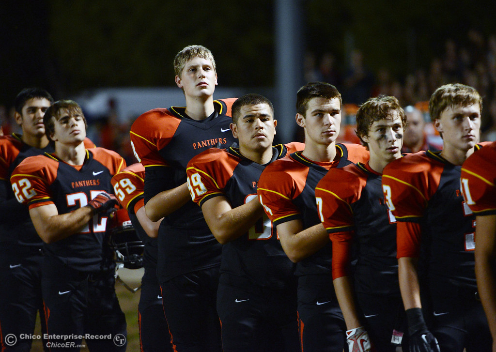 . Chico High\'s team stand for the National Anthem against Central Valley High in the first quarter of their football game at Asgard Yard Friday, September 27, 2013, in Chico, Calif.  (Jason Halley/Chico Enterprise-Record)