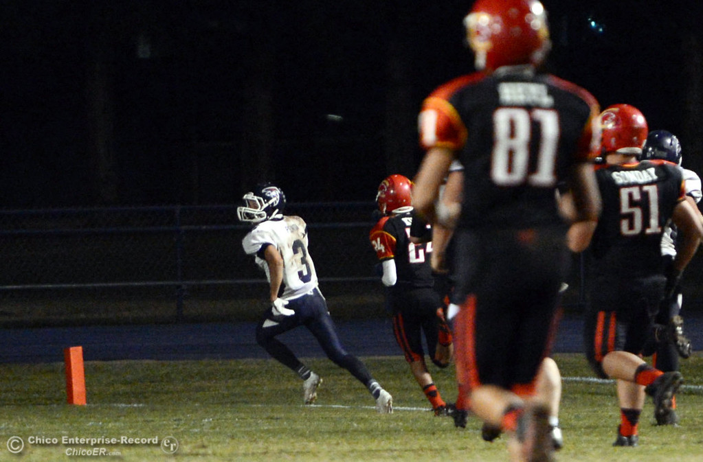 . Central Valley High\'s #3 Tony Penta (left) rushes for a touchdown against Chico High in the third quarter of their football game at Asgard Yard Friday, September 27, 2013, in Chico, Calif.  (Jason Halley/Chico Enterprise-Record)