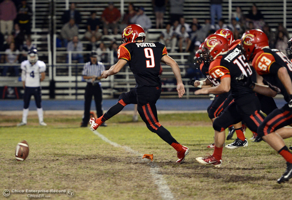 . Chico High\'s #9 Tim Porter kicks off against Central Valley High in the first quarter of their football game at Asgard Yard Friday, September 27, 2013, in Chico, Calif.  (Jason Halley/Chico Enterprise-Record)