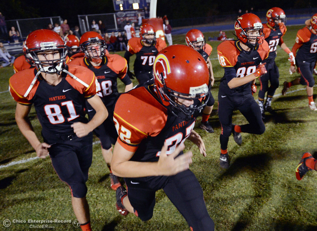 . Chico High #81 Nathan Heyl (left) and #32 Ryan Calbert (right) run onto the field with his team against Central Valley High before the first quarter of their football game at Asgard Yard Friday, September 27, 2013, in Chico, Calif.  (Jason Halley/Chico Enterprise-Record)