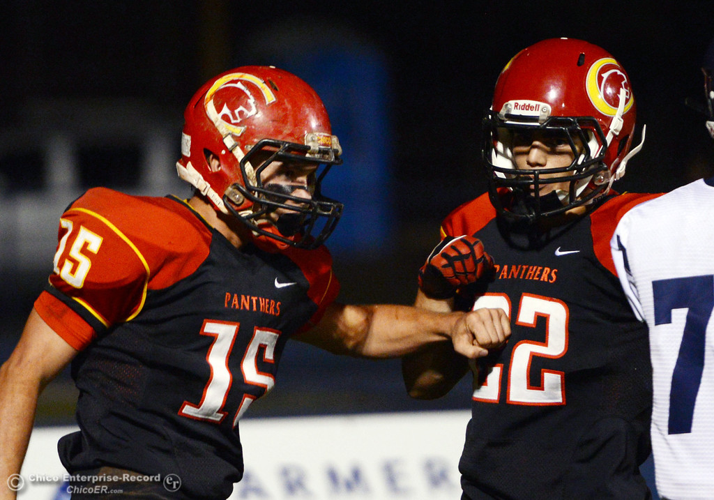 . Chico High\'s #15 Miles Fishback (left) reacts with #22 Paolo DiSano (right) after Fishback scored a touchdown against Central Valley High in the first quarter of their football game at Asgard Yard Friday, September 27, 2013, in Chico, Calif.  (Jason Halley/Chico Enterprise-Record)