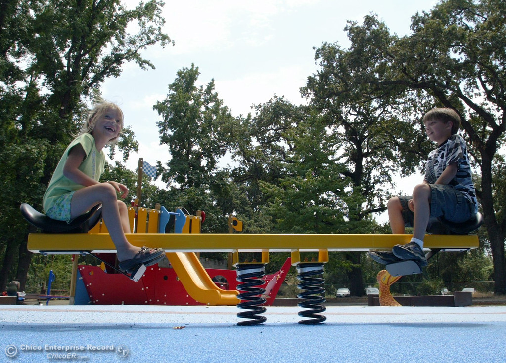 . Kylie Gollmer, 6 (left) and Nick Gollmer, 10 (right), of Phoenix, AZ, rock on a seesaw as kids play at the Nico Cardoza Memorial Park in Caper Acres in this file photo from July 2007. (Jason Halley/Chico Enterprise-Record)