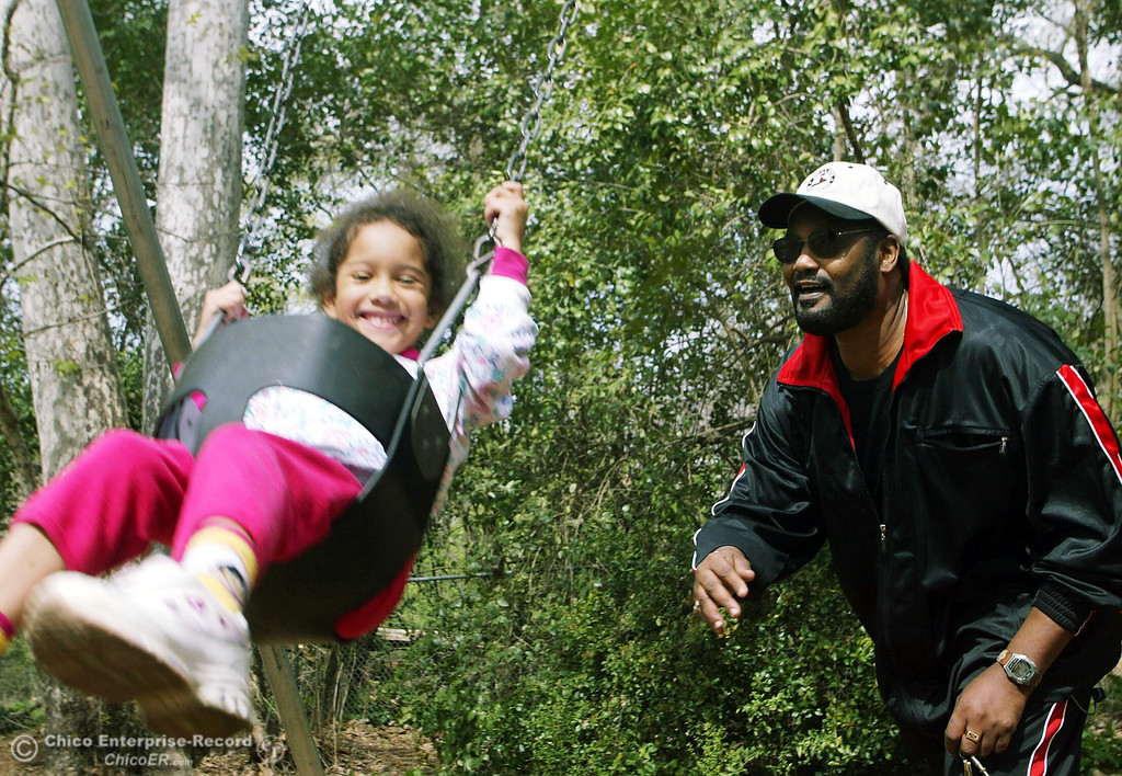 ". David Johnson gives his daughter, Katie, 5, a little push on the swing in Caper Acres Saturday for the ""Head Start\"" father/male picnic with their kids in this file photo from March 2003. Johnson has two other sons, but has a \""special day\"" with his daughter every Saturday. (Glenn Fuentes/Chico Enterprise-Record file photo)"