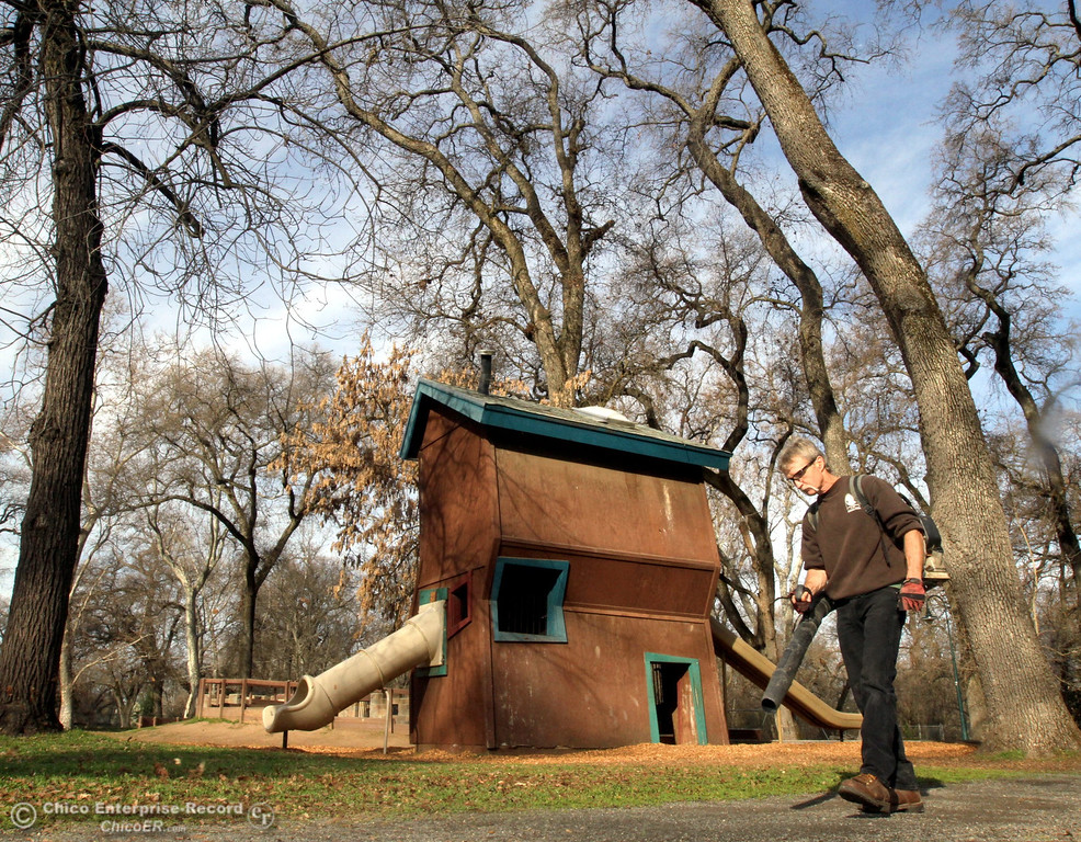 ". City of Chico Senior Maintenance worker Billy Robinson clears a path next to the ""Crooked House\"", which is closed for repairs and will be open for play soon at Caper Acres in this file photo from February 2012. (Ty Barbour/Chico Enterprise-Record)"