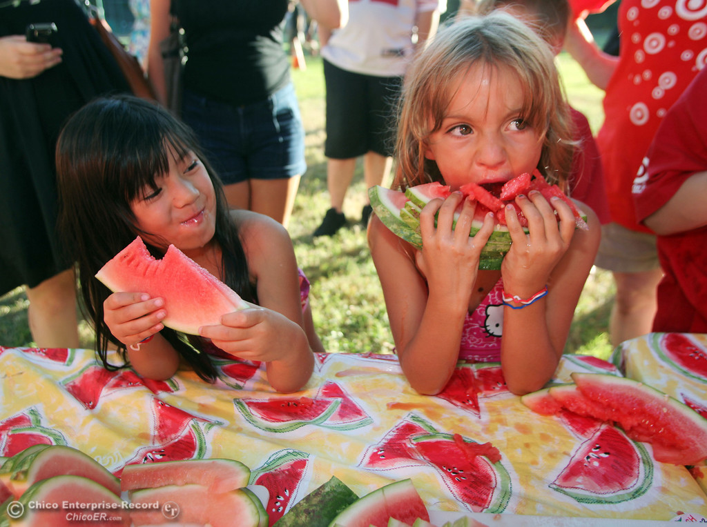 . Riley Ruiz, 6 (left) and Hailey Adams, 6 (right) bite into their watermelons during the watermelon eating contest as the public spend their night at Caper Acres participating in National Night Out in this file photo from August 2011. (Jason Halley/Chico Enterprise-Record)