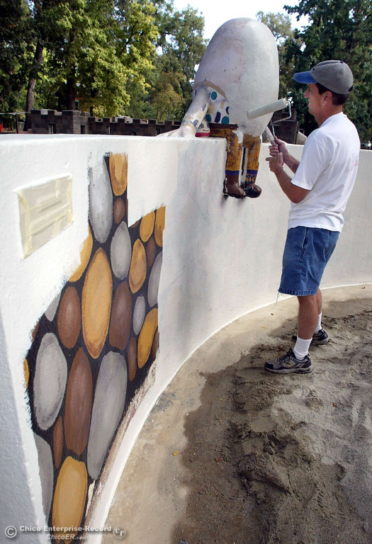 . Dan Herbert puts on a coat of base paint on Humpty Dumpty as  members of the Chico Rotary Club volunteered cleanup projects at Caper Acres in this file photo from October 2006. (Ty Barbour/Chico Enterprise-Record file photo)