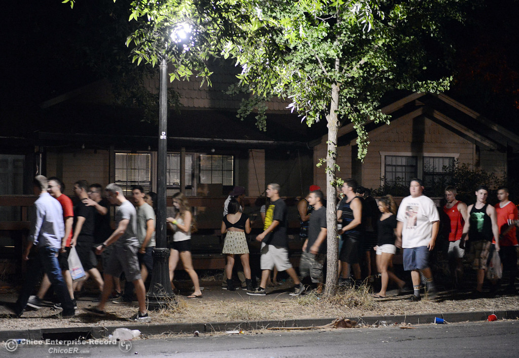 . A crowd moves north along Ivy St. near W. 7th St. as Chico Police responded to large incidents in the south campus area Friday, August 23, 2013 in Chico, Calif. 