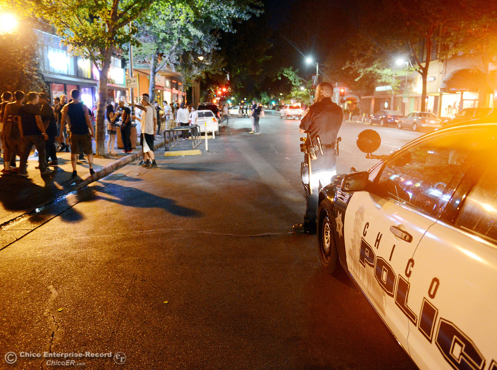 . Patrons leave the La Salles bar as Chico Police responded to large incidents in the downtown area Friday, August 23, 2013 in Chico, Calif. 