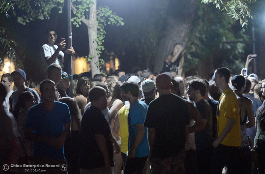 . People gather at W. 6th St and Ivy St. and Chico Police responded to large incidents in the south campus area Friday, August 23, 2013 in Chico, Calif. 