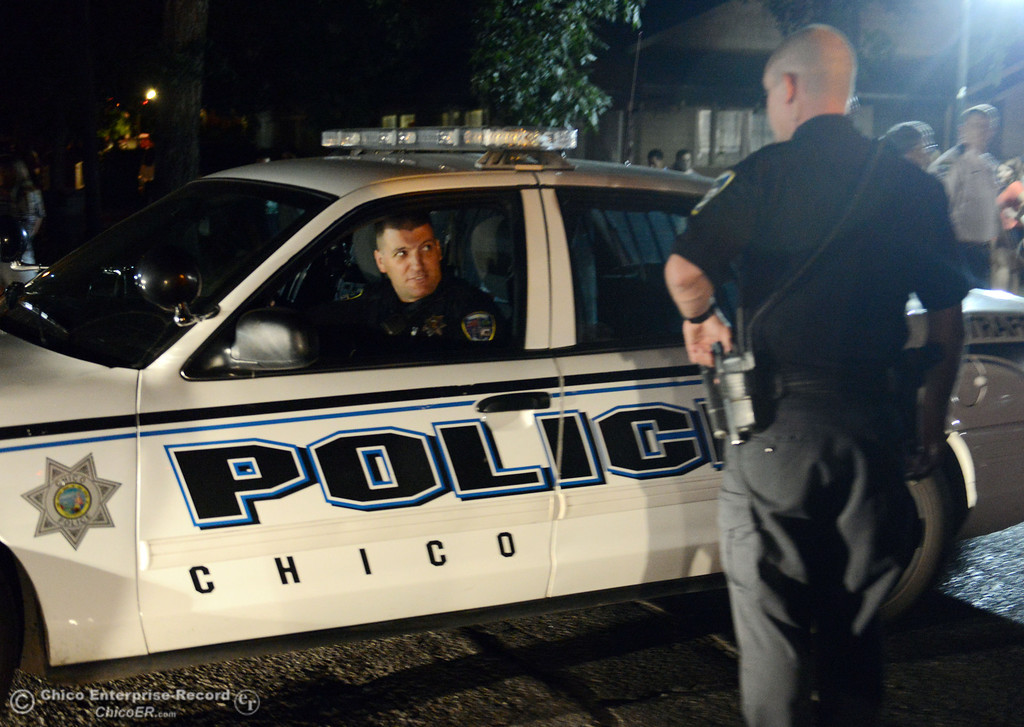 . Chico Police officer Tony Ferreira (left) responded to large incidents in the south campus area Friday, August 23, 2013 in Chico, Calif. 