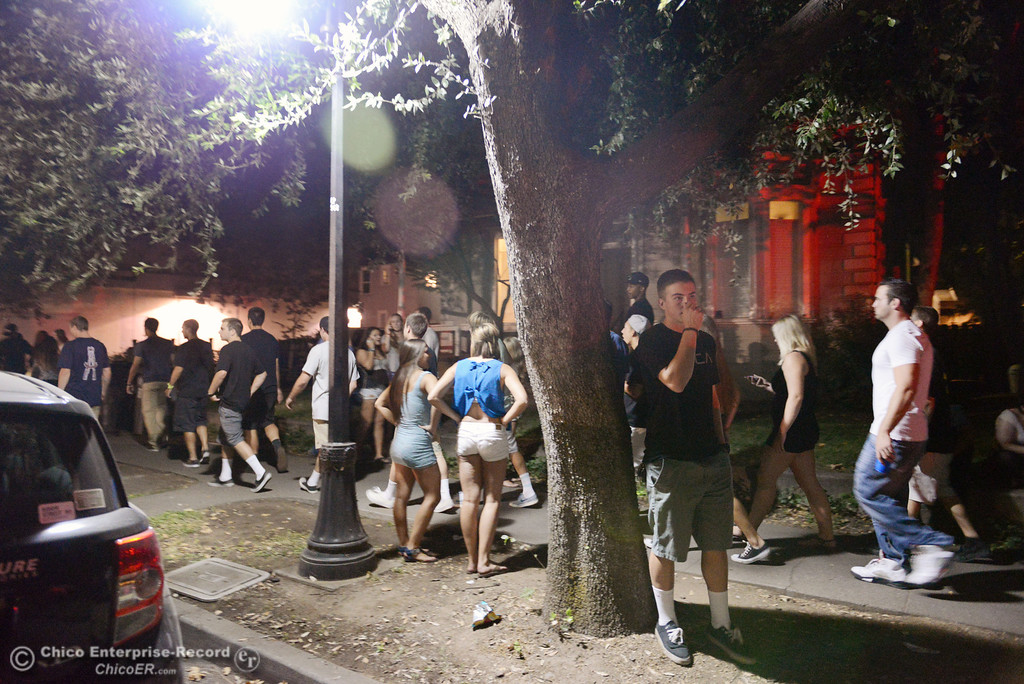. A crowd moves north along Ivy St. near W. 6th St. as Chico Police responded to large incidents in the south campus area Friday, August 23, 2013 in Chico, Calif. 